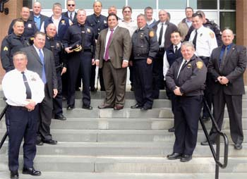 Mayor Carlo DeMaria (center) stands with members of the Evererr Police and Fire Departments during the honoring of superior police and fire officers luncheon.